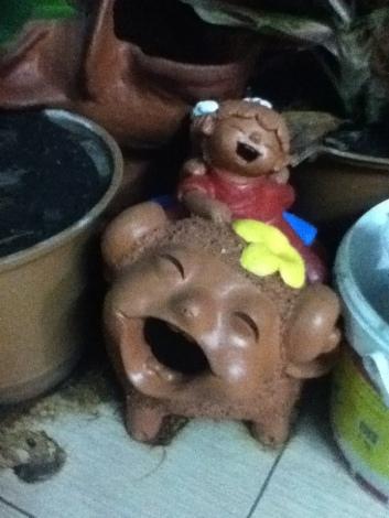 Thai laughing statues at U-Baan guesthouse, Bangkok