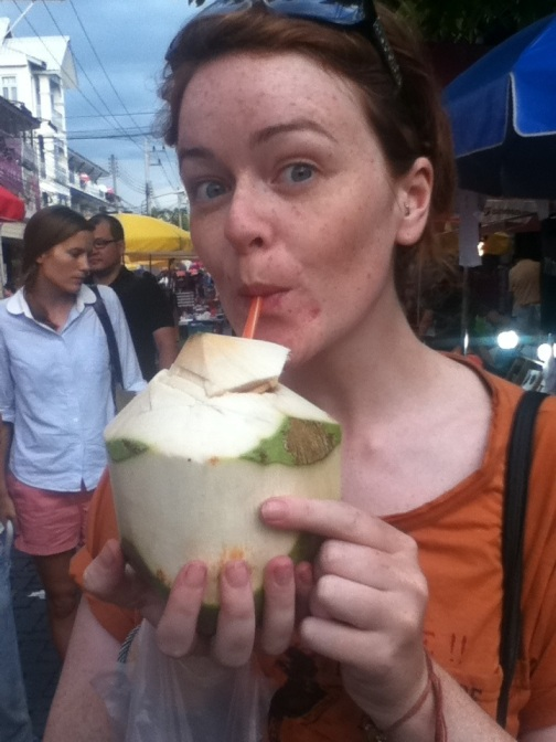 Drinking from a young coconut in Chiang Mai