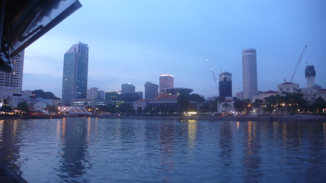 Sunset view of Singapore Quay and city