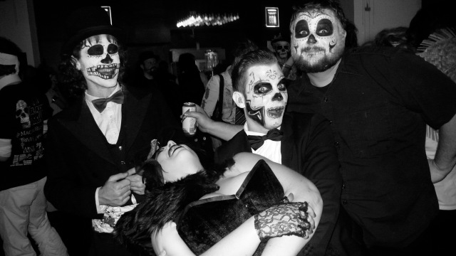The voodoo gang at White Mischief Phantasmagoria Halloween Ball mexican day of the dead make up