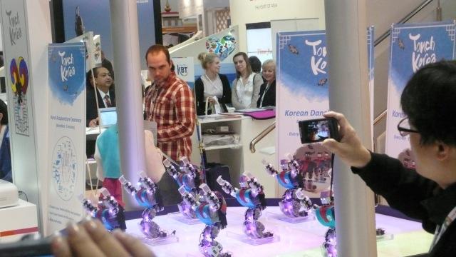 Dancing robots at World Travel Market 2012 Korea Stand